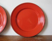 vintage red-orange enamel plates