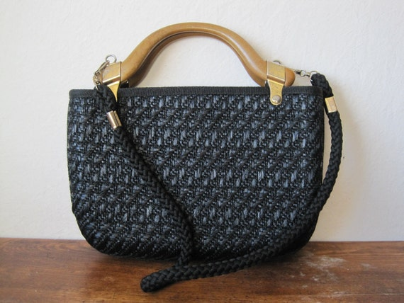 vintage black woven purse with wooden handles and long strap