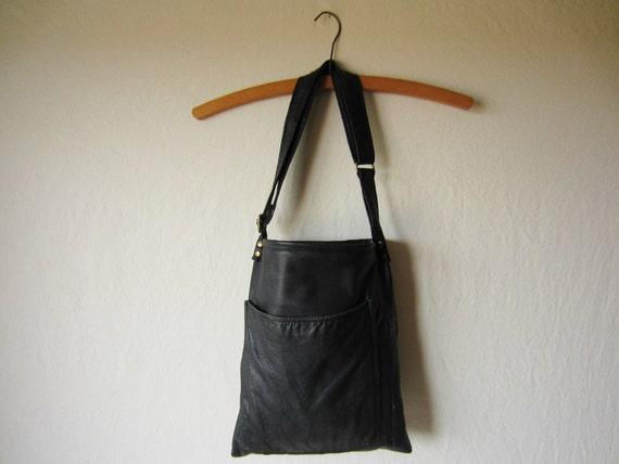 black leather bag with adjustable strap and large exterior pocket