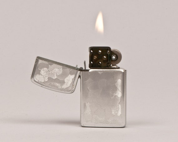 1950s Storm King Lighter With Embossed Jigsaw Design