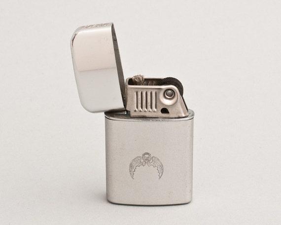 Vintage Flying Skull Ronson Typhoon Pocket Lighter NOS