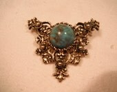 Lovely gold toned Victorian style brooch by Sarah Coventry
