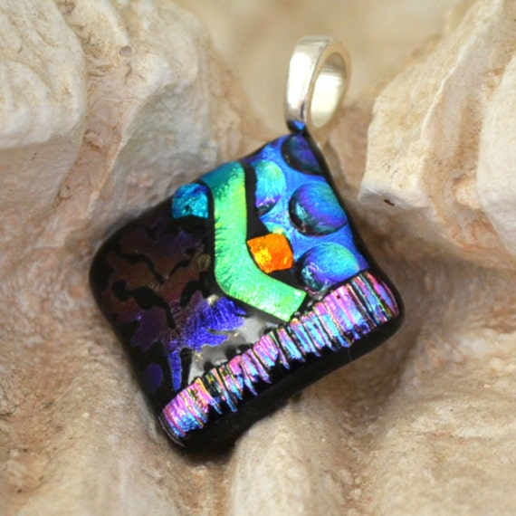 "dichroic glass pendant  fused with texture.. multicolored..  Silver bail.  1"" square"