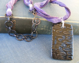 Black Magic Necklace: Ceramic Pendant from Marsha Neal Studio with Dark Brass and Purple Silk Ribbon