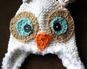 Owl hat white with fuzzy border. Available in all sizes