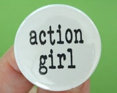action girl.  1.25 inch button. because you get things done, and that makes you awesome