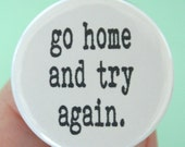go home and try again. 1.25 inch button. because bad outfits, hair, and fail in general, bores you.