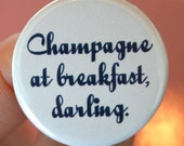 champagne at breakfast, darling. 1.25 inch button. each day is a great reason to celebrate with a flute of bubbly.