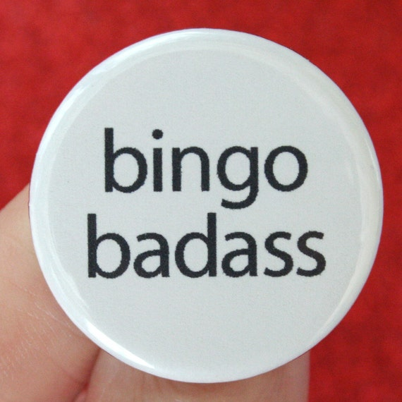bingo badass. 1.25 inch button. You win without trying, and are the envy of your bingo playing friends. win big--wear this pin.