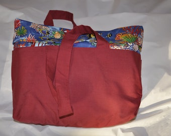 Bag in dark red with fish lining
