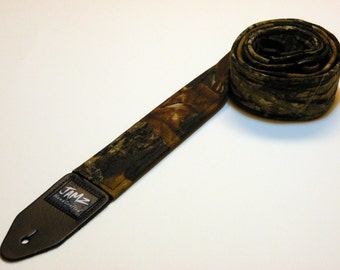 Handmade double padded guitar strap made with MOSSY OAK fabric - This is NOT a licensed product