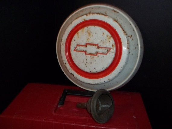 Chevy Hubcap 1950's and Antique Brass Oil Funnel