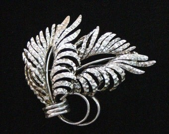 Oscar silvertone hammer looking brooch