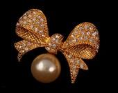 Bridal brooch or hair comb pearl gold diamond rhinestone bow