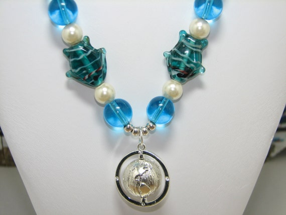 Beaded Necklace In Aqua Blue with Pearl and Lampwork Fish with Silver Spinning Globe Pendant