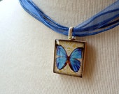 Scrabble Tile Pendant Blue Butterfly by Foundation 18 on Etsy - Funds to Orphanage