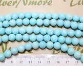 A strands of 8mm Round Blue Dyed Sponge Coral