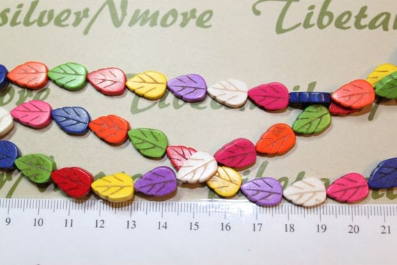 16 inches of 14x10mm Flat Leaves Multi-color Dyed Magnesite.