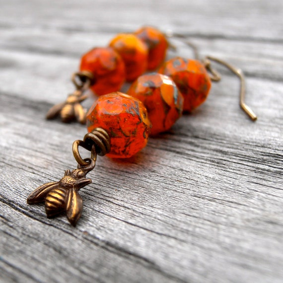 orange and antique brass bee charm earrings, orange beaded earrings, handmade earrings,