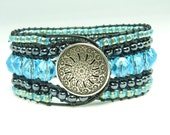 Beaded cuff bracelet - black and turquoise leather wrap style cuff - on black leather.