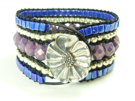 Beaded cuff bracelet - purple and lavender and blue on black leather- flower closure, springtime jewelry.