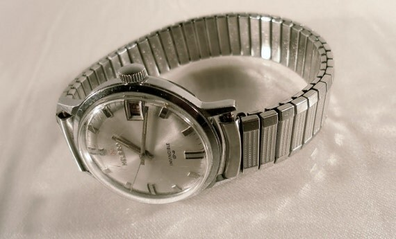 Vintage 1960's Helbros Invincible 17J Wind Up Manual Watch w Speidel Twist Band.  Good Working Condition.
