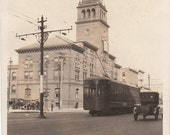 Vintage/Antique photo of a City hall and an old cable car