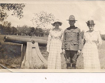 Vintage/Antique photo of 2 women and a man in military uniform