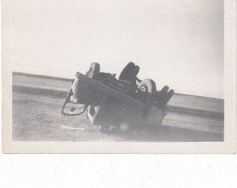 Vintage/Antique photo of an upside down truck