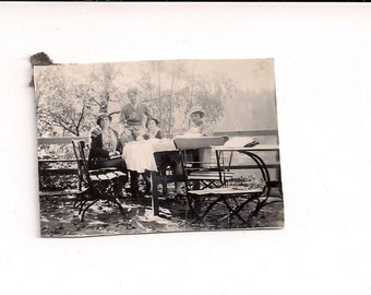 Vintage/Antique photo a 3 women and man having picnic at the park