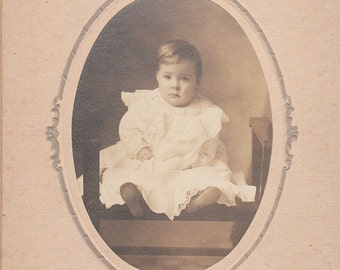 Vintage/Antique cabinet  photo of a beautiful baby wearing a long dress