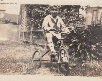 Vintage/Antique  photo of a cute boy on his trike