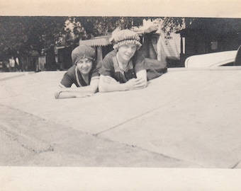 Vintage/ Antique Photo of two women posing on their belly wearing a shower cap