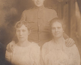 Vintage/Antique postcard photo of 2 women and a man in military uniform