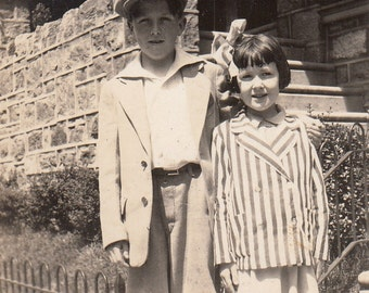 Vintage/ Antique Photo of a boy in an suit and a cute girl with an oversized bow and stripe jacket