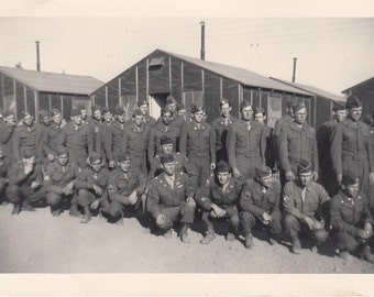 Vintage/Antique photo of a gathering of men in a military uniform