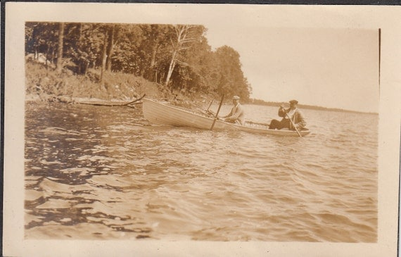 Vintage/ Antique photo of two men in a canoe