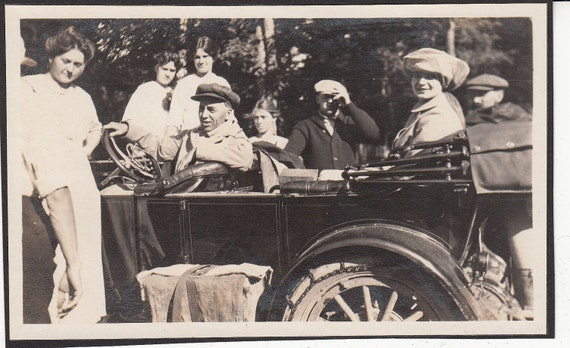 Vintage/Antique photo of men, women and a beautiful  shiny vintage top down car