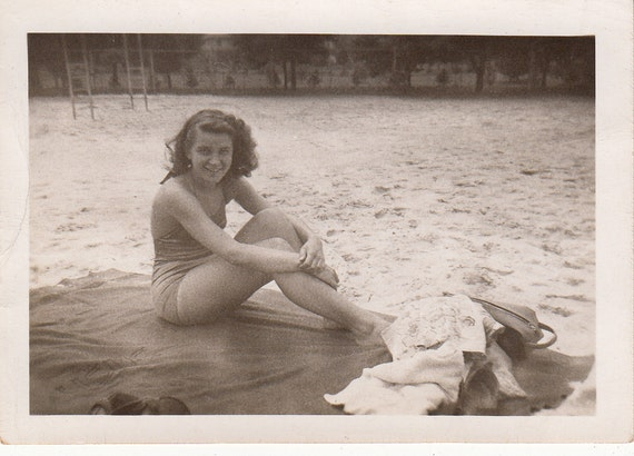 Vintage/ Antique Photo of a beautiful woman sun bathing by the lake