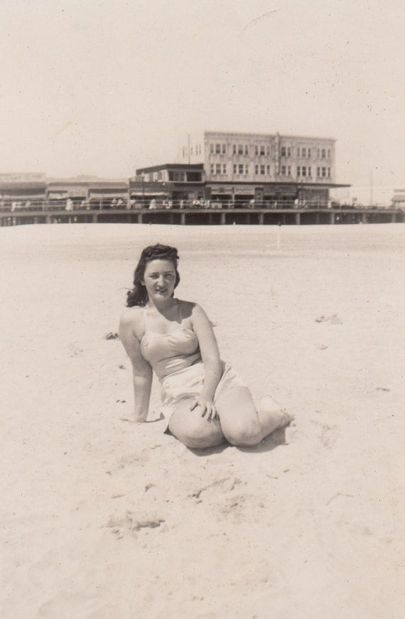 Vintage/ Antique Photo of a beautiful woman sun bathing by the beach