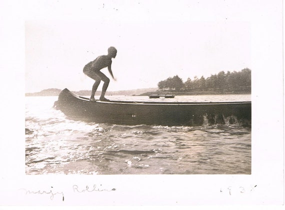 vintage black & white photo - canoe swimming bathing suit cap camp summer lake balance girl woman lady teen