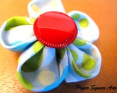 Red Clown Flower Clip in blue fabric with green, creme and baby blue polka dots
