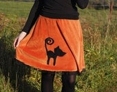 One of a kind pumpkin orange velour skirt with a black cat applique. Cute Haloween garment