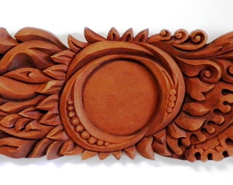 Fire from the Sun- woodcarved decorative panel