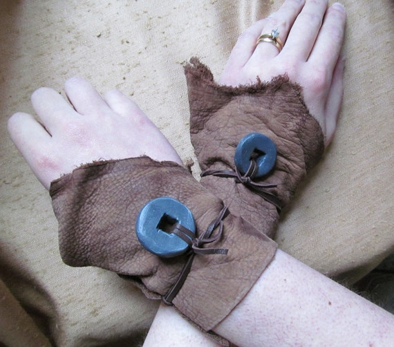 Pair of Leather Wrist Wrap Cuffs with Millstones
