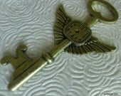 Steampunk skeleton key pendant 3 inches charm wings clock antique brass vintage look.