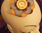 Blue and beige felt flower hair clip with button, retro style