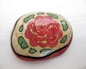 The rose - inspired hand painted stones