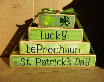 Wooden blocks St. Patricks Day stacker decoration for the holidays with lucky Irish leprechaun shamrock rock four leaf clover