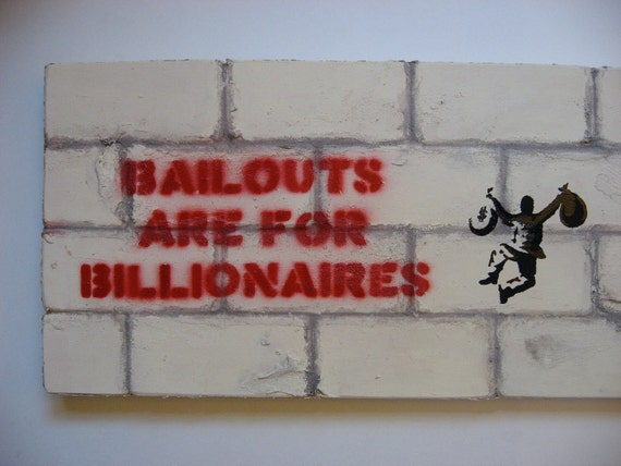Wooden Sculpture Graffiti: Bailouts are for Billionaires, Taxes are for The Poor